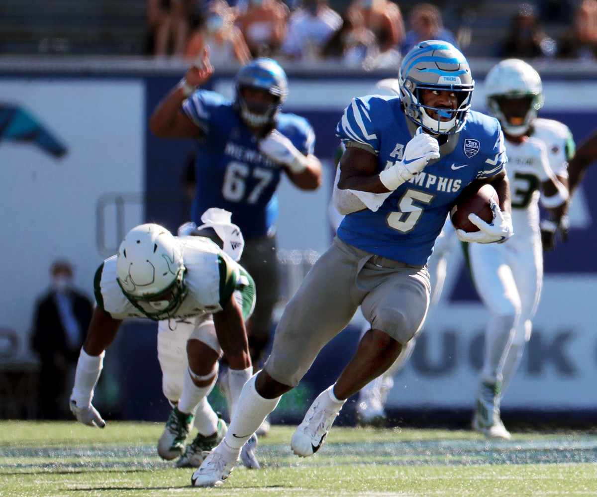 <strong>University of Memphis tight end Sean Dykes (5) breaks away from a tackle during the second quarter of a Nov. 7, 2020 home game against the University of South Florida.</strong> (Patrick Lantrip/Daily Memphian)