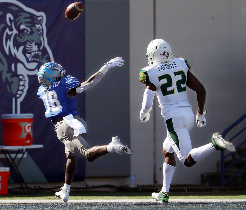 <strong>University of Memphis receiver Tahj Washington (18) stretches out for an overthrown ball during the first quarter of a Nov. 7, 2020 home game against the University of South Florida.</strong> (Patrick Lantrip/Daily Memphian)