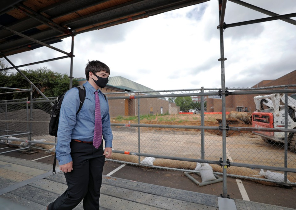 <strong>A Christian Brothers High School student (in a Sept. 3, 2020 photo) passes construction where the school's new fieldhouse is being built.</strong>&nbsp;(Patrick Lantrip/Daily Memphian file)