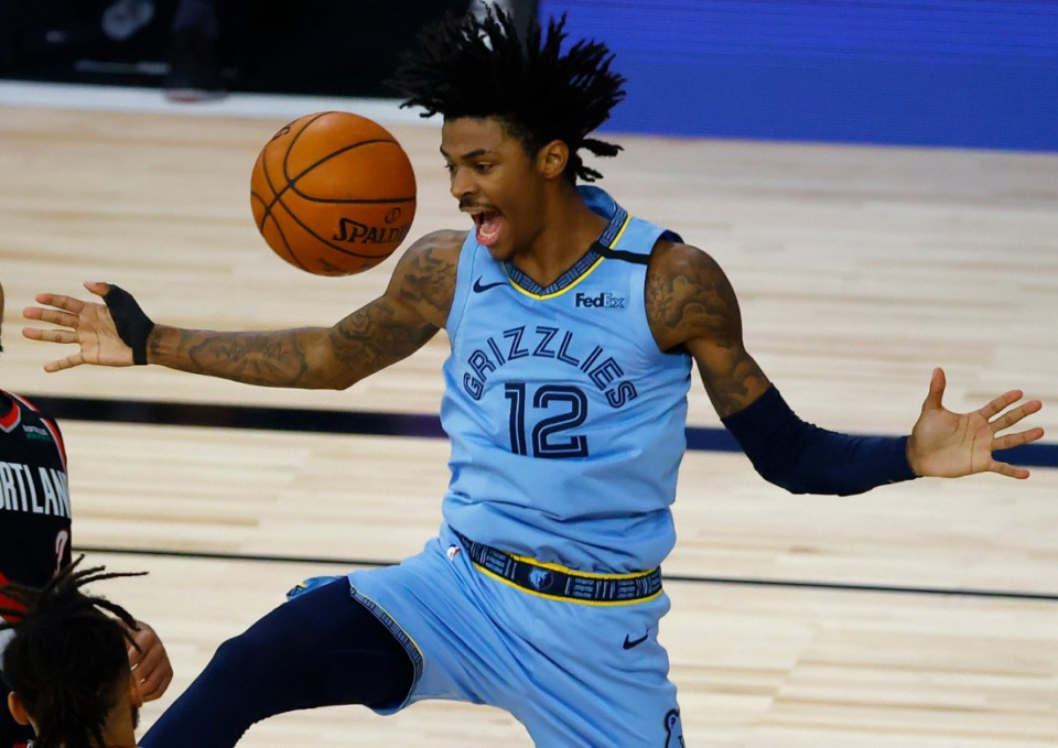<strong>Ja Morant (reacting after a dunk against the Portland Trail Blazers Saturday, Aug. 15, 2020, in Lake Buena Vista, Fla.) can help the Grizzlies attract a star player says former Grizz player Mike Miller.</strong> (Kevin C. Cox/AP file))
