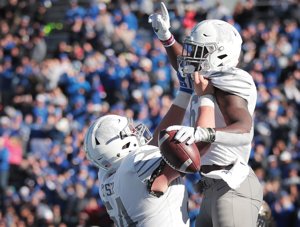 <strong>University of Memphis running back Patrick Taylor Jr. (right) celebrates with offensive lineman Drew Kyser after a touchdown against Wake Forest during the Birmingham Bowl on Dec. 22, 2018, at Legion Field in Birmingham, Ala.</strong> (Jim Weber/Daily Memphian)