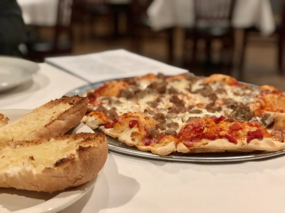 <strong>Pizza, like this Italian sausage one, is, of course, on the menu at Elfo Pizzeria.</strong> (Jennifer Biggs/Daily Memphian)