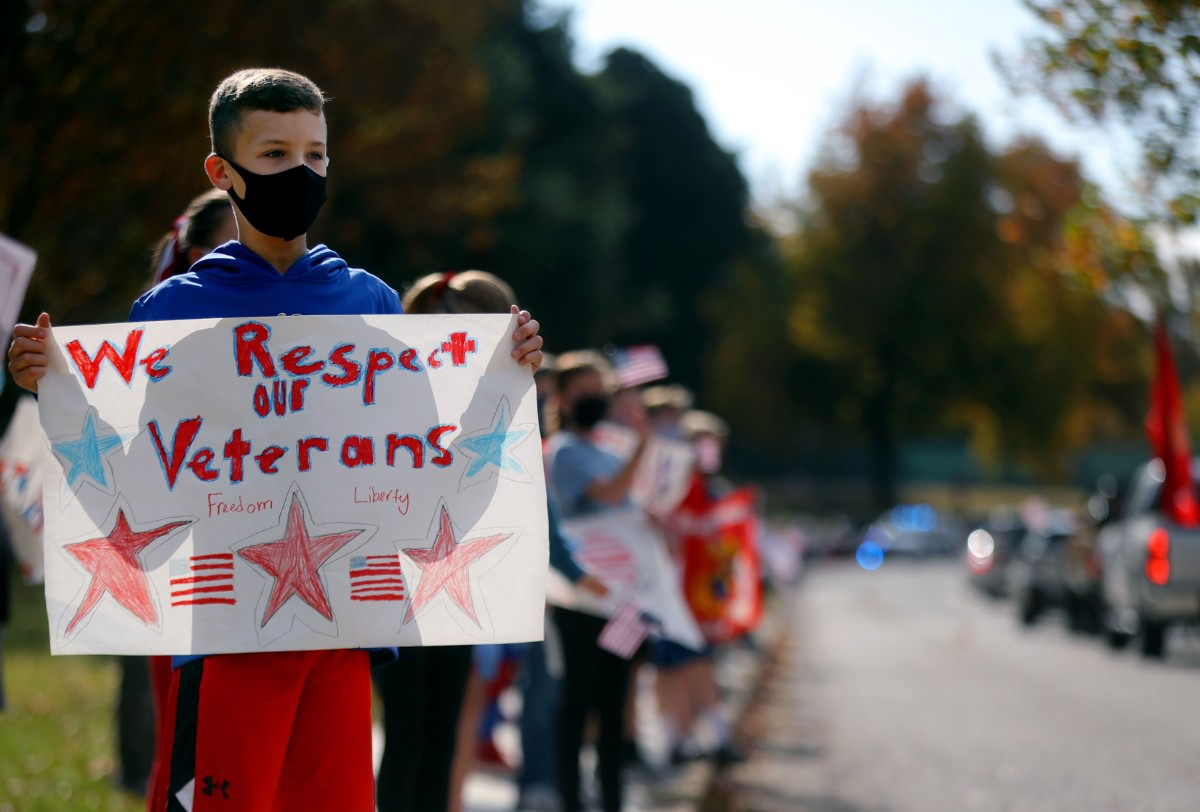 <strong>Cole Savage holds a sign thanking a caravan of veterans who were visiting Dogwood Elementary for Veterans Day Nov. 11, 2020</strong>. (Patrick Lantrip/Daily Memphian)