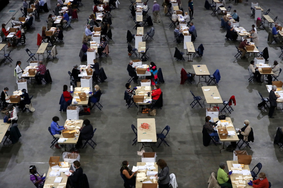 <strong>Vote counters sit in neat rows as the sort through absentee ballots at the FedExForum Nov. 3, 2020.</strong> (Patrick Lantrip/Daily Memphian)