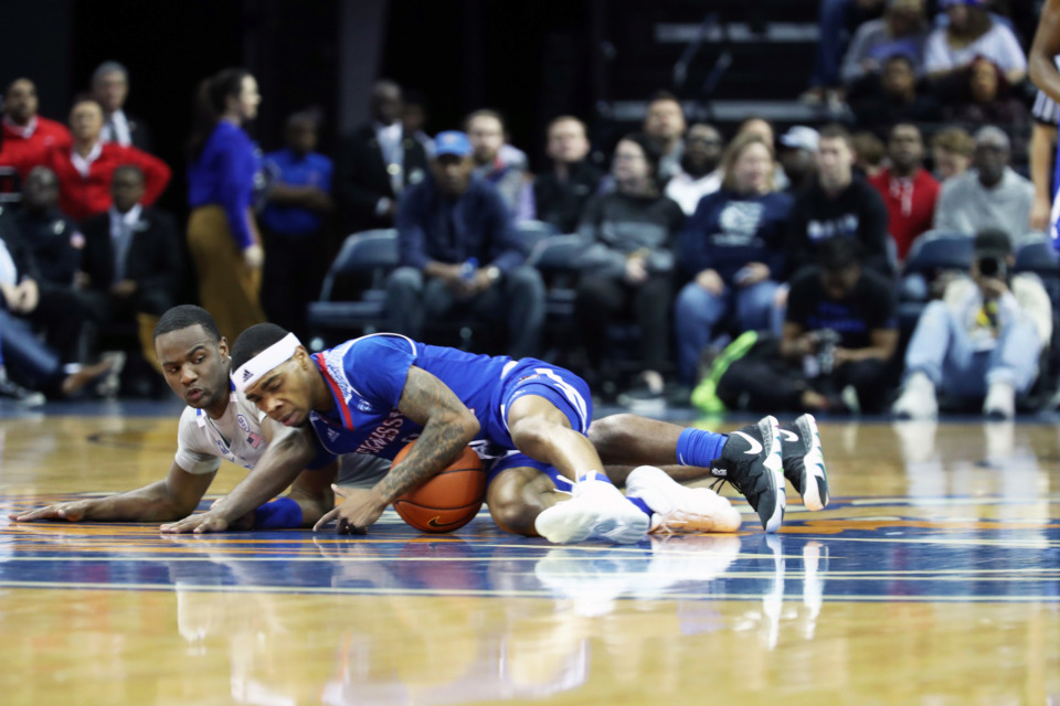 "<strong>University of Memphis' Alex Lomax (2) and Tennessee State's Armani Chaney (0) scramble for the ball in the first half of&nbsp;</strong><span class=""s1""><strong>a game at FedExForum in Memphis on Saturday, Dec. 22, 2018.</strong> (Karen Pulfer Focht/Special to The Daily Memphian)</span>"