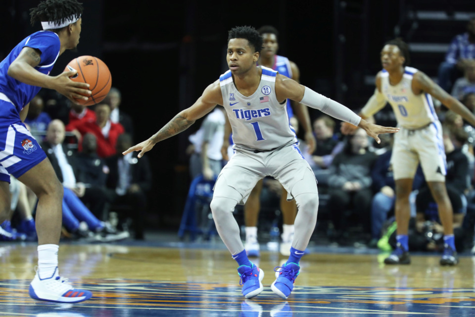 "<strong>University of Memphis' Tyler Harris (1) defends Michael Littlejohn (1) of the Tennessee State Tigers in the first half of&nbsp;</strong><span class=""s1""><strong>a game at FedExForum in Memphis on Saturday, Dec. 22, 2018.</strong> (Karen Pulfer Focht/Special to The Daily Memphian)</span>"