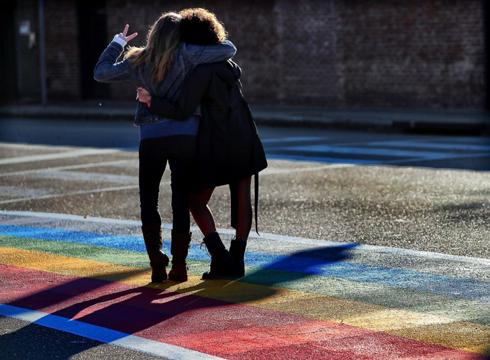 <strong>Cooper Young resident Lisa Paccasassi and Sarah Olson pause for a selfie at the state's first rainbow colored crosswalk at the corner of Cooper and Young Nov. 3, 2019. Locals are concerned about maintaining the character of the area.</strong>&nbsp;(Jim Weber/Daily Memphian file)