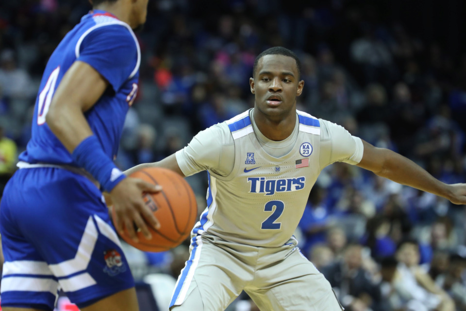 "<strong>Memphis Tigers Alex Lomax (2) guards Tennessee State Tigers Armani Chaney (0) in the first half of&nbsp;</strong><span class=""s1""><strong>a game at FedExForum in Memphis on Saturday, Dec. 22, 2018. </strong>(Karen Pulfer Focht/Special to The Daily Memphian)</span>"