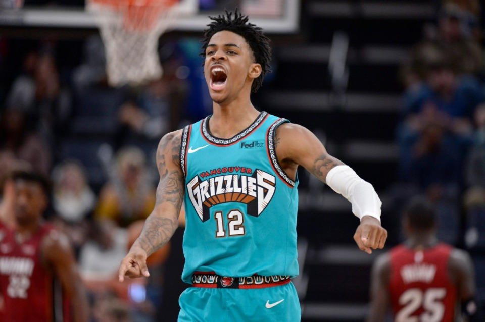 <strong>Memphis Grizzlies guard Ja Morant (in a Dec. 16, 2019 game against the Miami Heat at FedExForum) told Twitter fans the Vancouver throwback uniform is his favorite.</strong> (Brandon Dill/AP file)