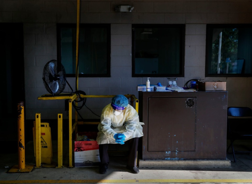 <strong>A Christ Community Health Services staff member waits for patients at a drive-thru coronavirus testing site on Wednesday, Oct. 20, 2020 on Lamar Avenue.</strong> (Mark Weber/The Daily Memphian)