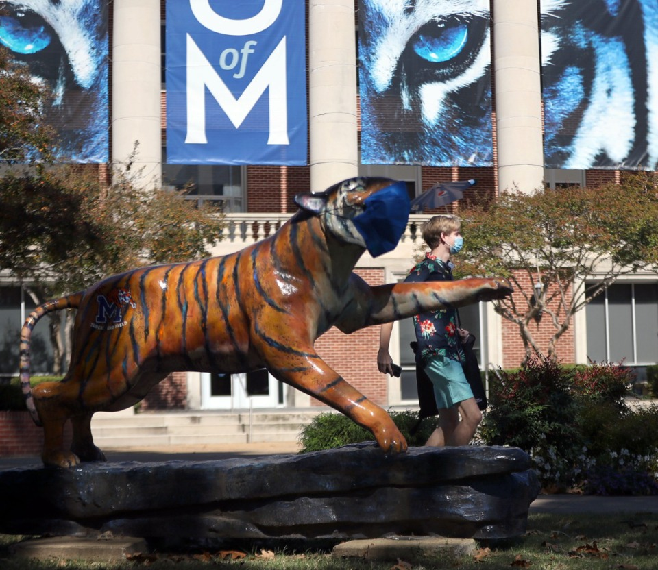 <strong>A University of Memphis student walks past a tiger stature on the main, Central Avenue campus Oct. 13, 2020.</strong> (Patrick Lantrip/Daily Memphian)
