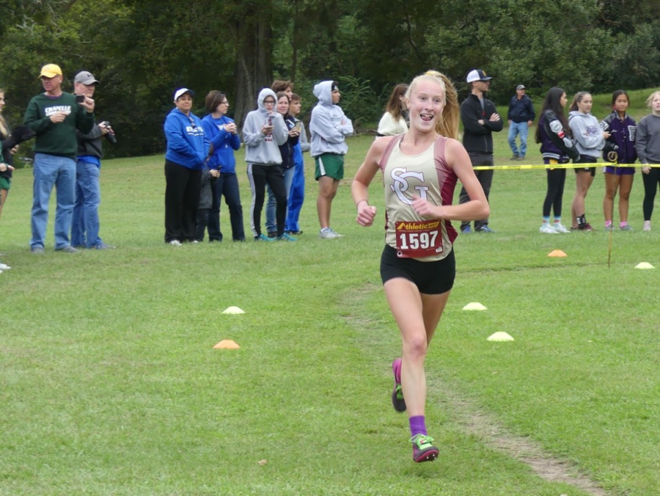 <strong>Allison Newman, who was named Daily Memphian cross-country runner of the year in 2019, signed a National Letter of Intent Wednesday, Nov. 11 to run at Missouri.</strong> (Courtesy photo)