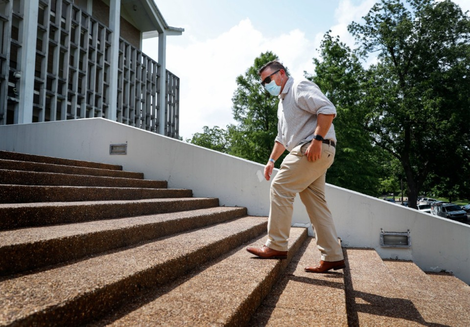 <strong>Memphis Parks and Neighborhoods director Nick Walker (in a file photo), climbs the steps of Rust Hall in Overton Park.</strong> (Mark Weber/Daily Memphian)