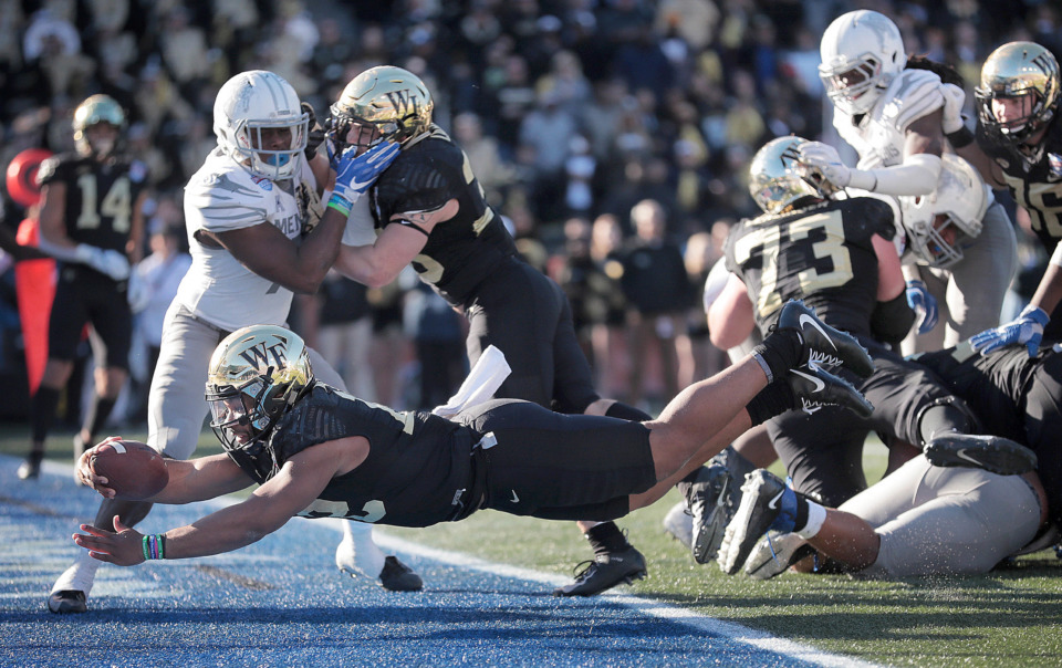 <strong>Wake Forest quarterback Jamie Newman dives into the end zone for the game-winning touchdown against the University of Memphis during the Birmingham Bowl on Dec. 22, 2018, at Legion Field in Birmingham, Ala.</strong> (Jim Weber/Daily Memphian)