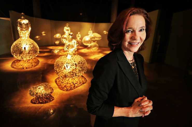 "<strong>Executive director Emily Ballew Neff of the Brooks Museum of Art, in front of the ""Talking Continents"" exhibit from Spanish artist Jaume Plensa.</strong> (Jim Weber/Daily Memphian)"