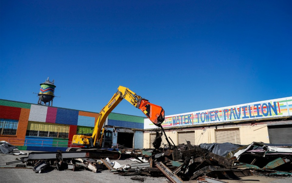 <strong>Demolition begins on the warehouse beneath the Broad Avenue water tower on Friday, Nov. 13, 2020, to make room for new apartments.</strong> (Mark Weber/The Daily Memphian)