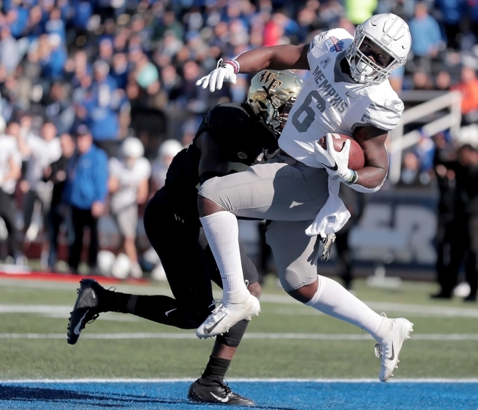 <strong>University of Memphis running back Patrick Taylor Jr. stumbles into the endzone to score a touchdown against Wake Forest during the Birmingham Bowl on Dec. 22, 2018, at Legion Field in Birmingham, Ala.</strong> (Jim Weber/Daily Memphian)