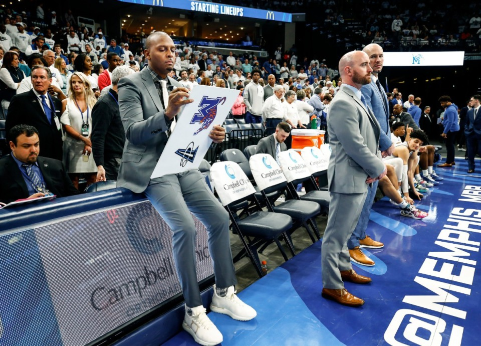 <strong>Memphis head coach Penny Hardaway (left) draws up plays on March 5, 2020, at FedExForum. Hardaway will lead his Tigers against Saint Mary&rsquo;s at the Bad Boy Mowers Crossover Classic in Sioux Falls, S.D., on Nov. 25 &mdash; provided COVID allows it.</strong> (Mark Weber/Daily Memphian)