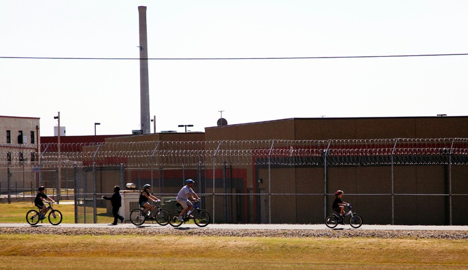 <strong>Bicyclists ride along the newly opened Greenline trail next to the Shelby County Penal Farm.</strong> (Lance Murphey/Daily Memphian file)