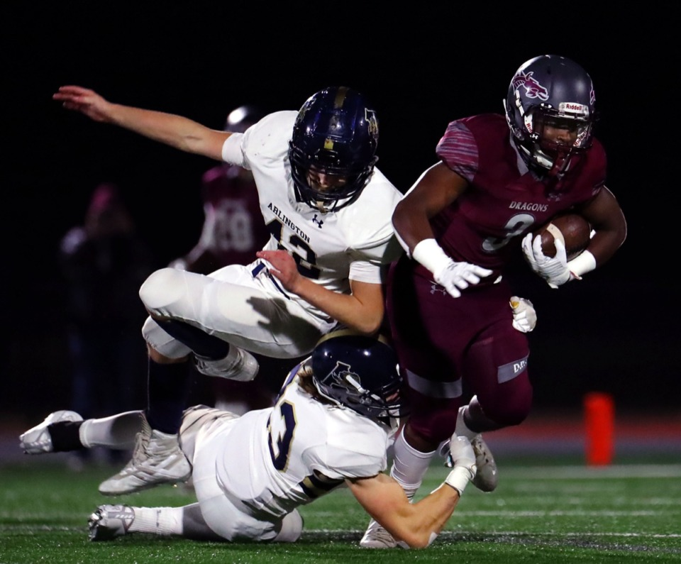 <strong>Collierville High School running back John Hampton III (3) gets taken down by a pair of Arlington High School players during a Nov. 13, 2020, home game.</strong> (Patrick Lantrip/Daily Memphian)