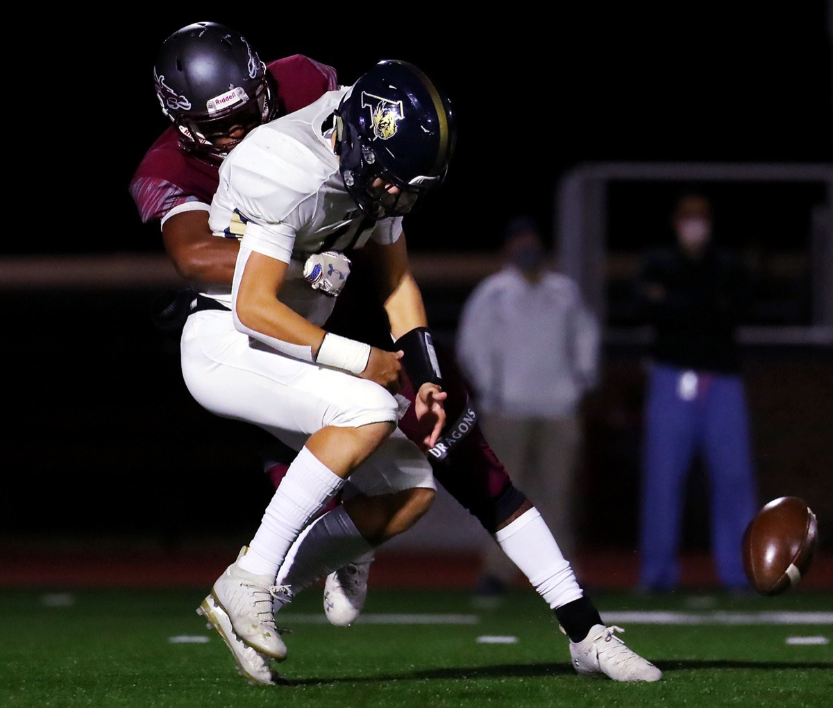 <strong>Arlington quarterback Zach Baker (15) gets the ball knocked out of his hands by a Collierville defender during a Nov. 13, 2020, road game.</strong> (Patrick Lantrip/Daily Memphian)