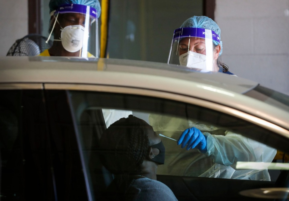<strong>Christ Community Health Services staff members collect nasal swabs during at a drive-thru coronavirus testing site on Wednesday, October 20, 2020 on Lamar Avenue.</strong> (Mark Weber/The Daily Memphian file)