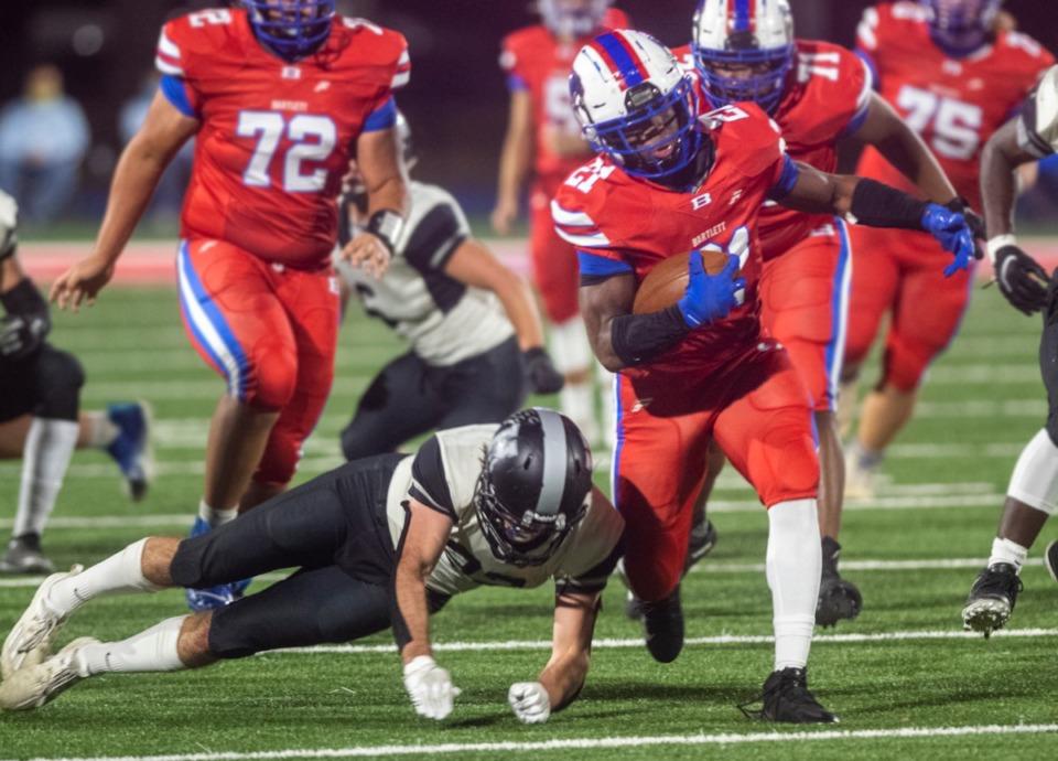 <strong>Bartlett High School running back Robert Giaimo avoids a block tackle from Houston High School linebacker Hudson Myatt in Saturday's district playoff game at Bartlett High School.</strong> (Greg Campbell/Special to The Daily Memphian)