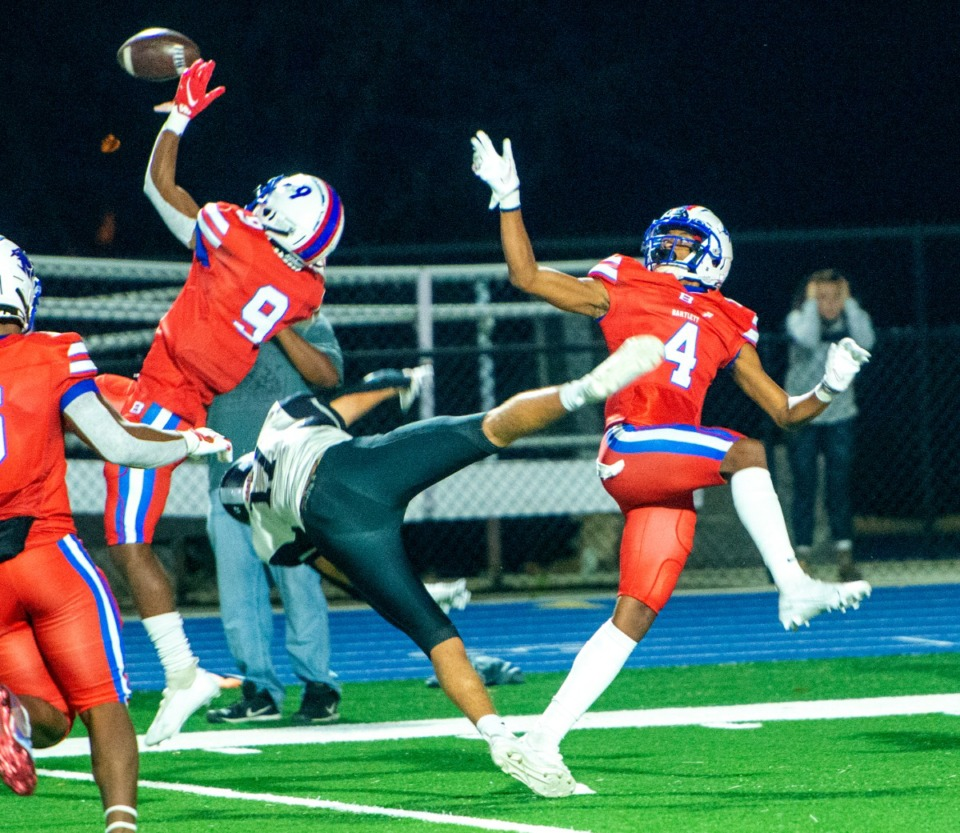 <strong>Bartlett High School safety Thomas Jones (9) and safety Marcio Smith (4) break up a pass to Houston High School receiver Alex Desarzant in the district playoff Saturday, Nov. 14, 2020.</strong> (Greg Campbell/Special to The Daily Memphian)