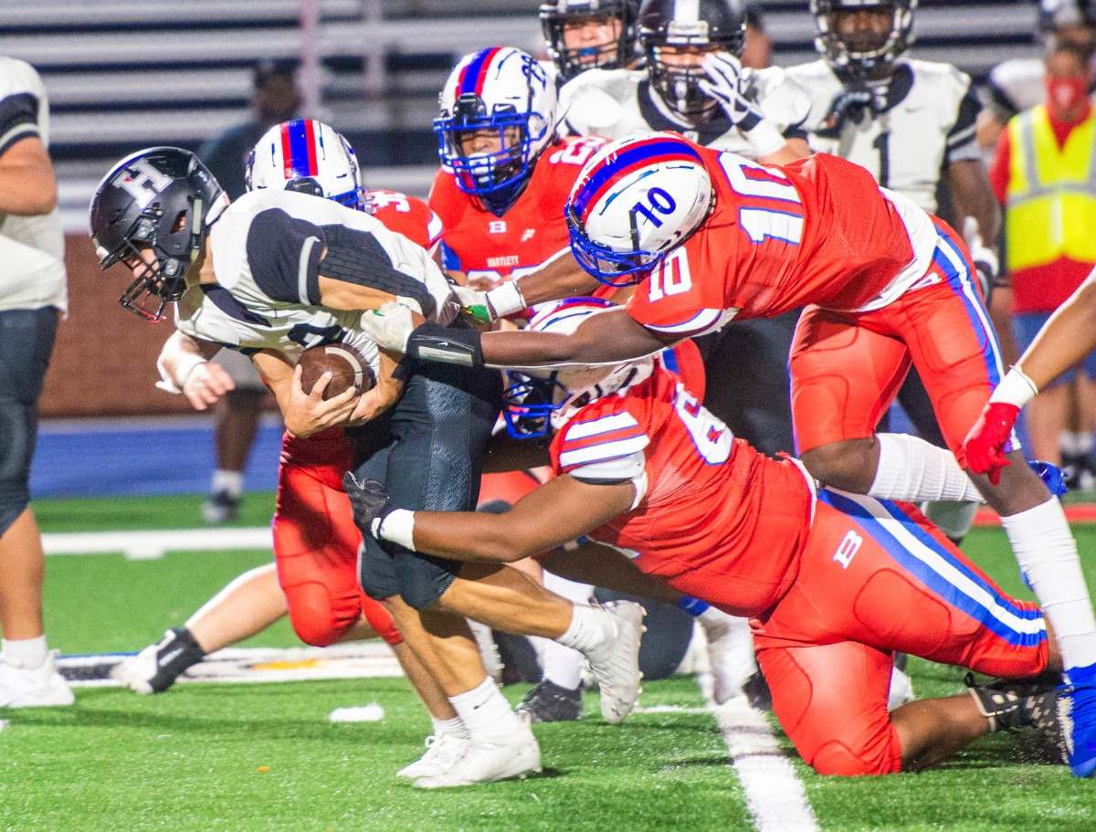 <strong>Houston High School running back Ben Stegall drags a host of Bartlett High School defenders in the first round of district playoffs Saturday, Nov. 14, 2020.</strong> (Greg Campbell/Special to The Daily Memphian)
