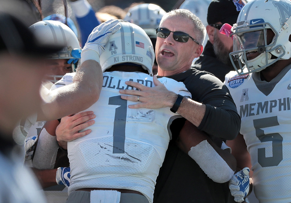 <strong>University of Memphis Coach Mike Norvell celebrates a touchdown with Tony Pollard (1) during the Birmingham Bowl on Dec. 22, 2018, at Legion Field in Birmingham, Ala.</strong> (Jim Weber/Daily Memphian)