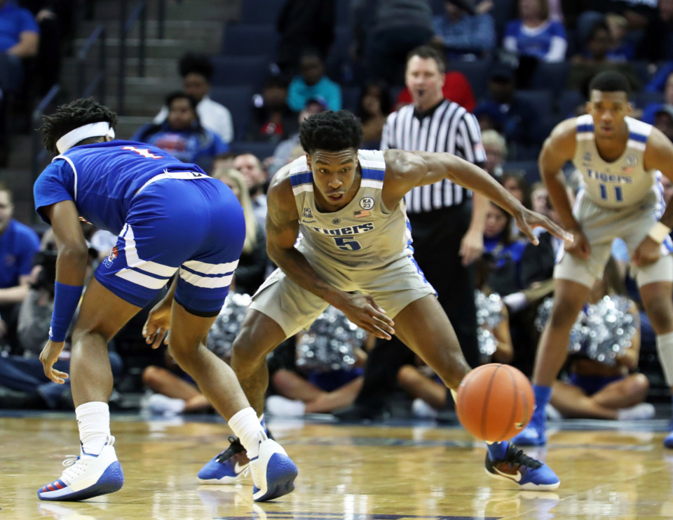 "<strong>University of Memphis guard Kareem Brewton (5) goes for the ball around Tennessee State's&nbsp; Michael Littlejohn in the second half of&nbsp;</strong><span class=""s1""><strong>a game at FedExForum in Memphis on Saturday, Dec. 22, 2018.</strong> (Karen Pulfer Focht/Special to The Daily Memphian)</span>"