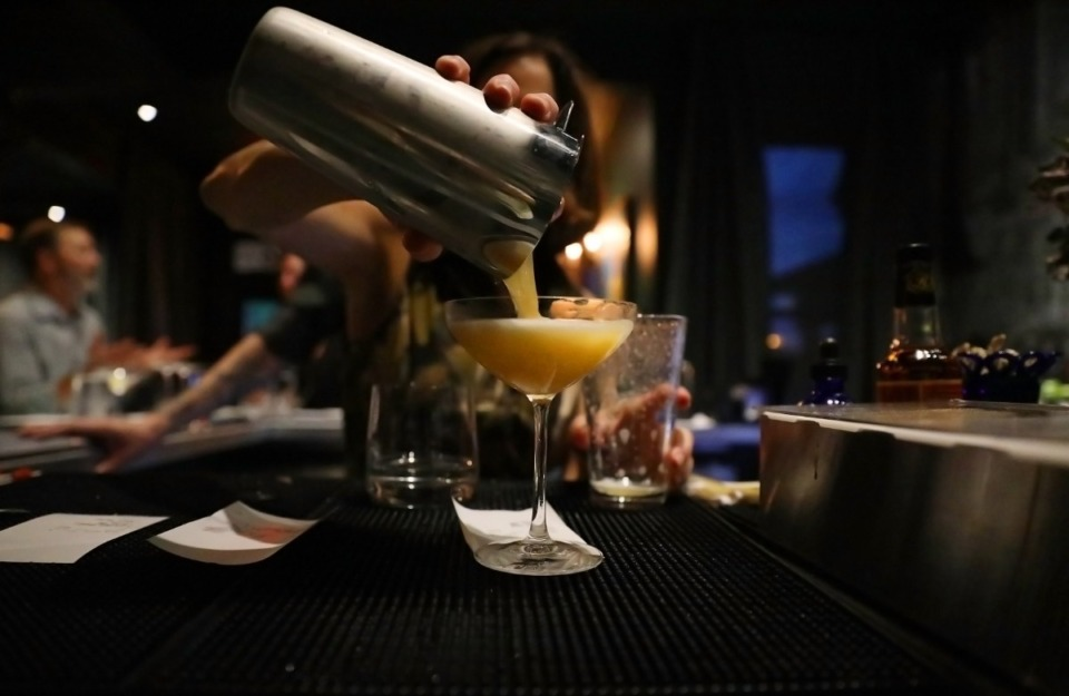 <strong>A bartender prepares one of the signature drinks at the Restaurant Iris.</strong> (Daily Memphian file)