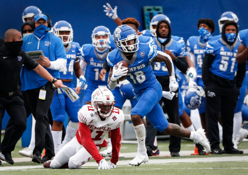 <strong>Memphis receiver Tahj Washington (right) makes a first down catch against the Temple defense during action on Saturday, Oct. 24, 2020 at Liberty Bowl Memorial Stadium.</strong> (Mark Weber/Daily Memphian)