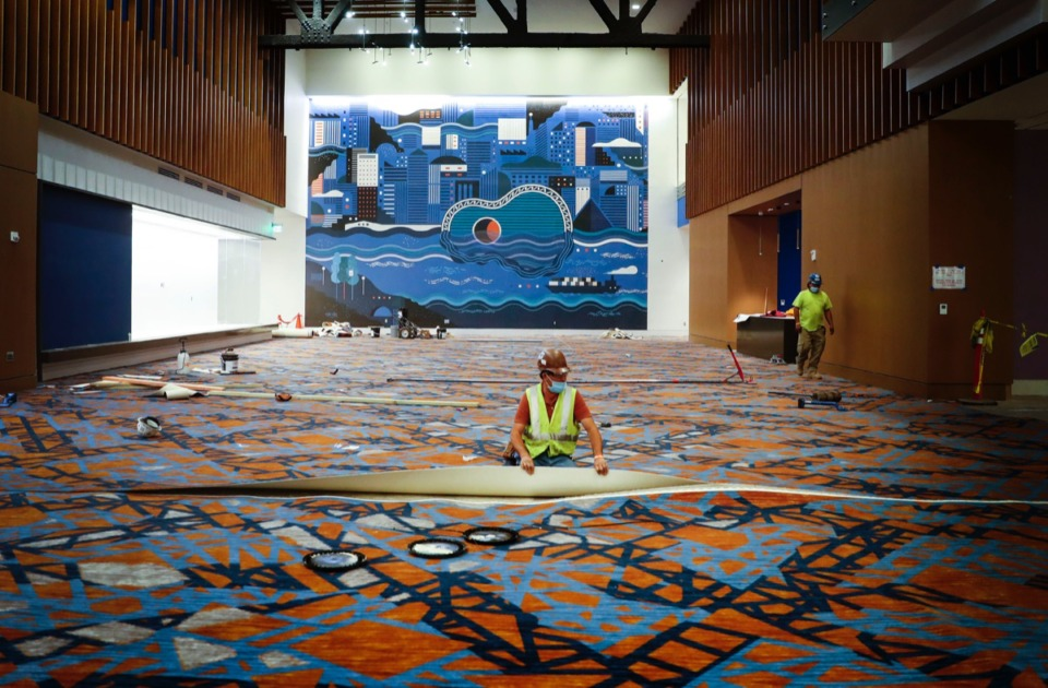 <strong>Workers lay new carpet inside the newly renovated Renasant Convention Center on Tuesday, Nov. 17, 2020.</strong> (Mark Weber/The Daily Memphian)