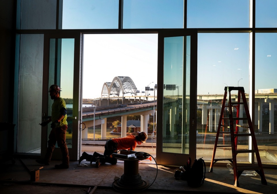 <strong>Construction workers place striping on a door leading to outdoor space at the newly renovated Renasant Convention Center on Nov. 17, 2020.</strong> (Mark Weber/The Daily Memphian)