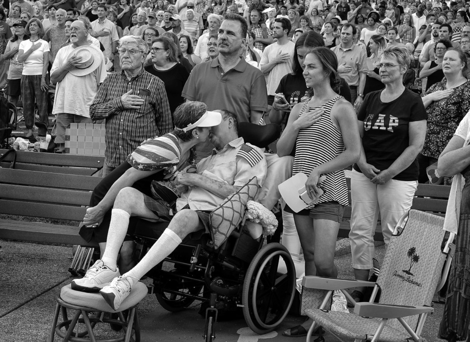 <strong>Bob Bolding attends an Independence Day ceremony with his wife, Ingrid, at one of their favorite places, the Levitt Shell. During the ceremony Bob tugs at Ingrid and asks for a kiss. At this point Bob is wheelchair bound and doesn't get out of the house much.</strong> (Karen Pulfer Focht/Special to The Daily Memphian)
