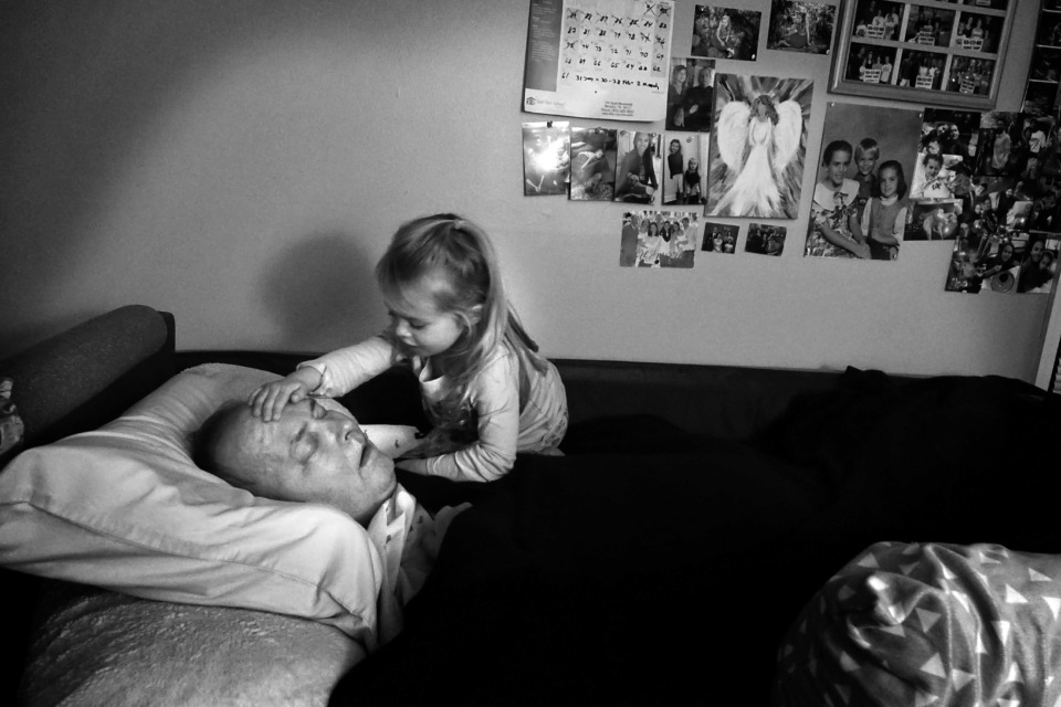 <strong>Two years after his diagnosis, Bob Bolding's granddaughter routinely climbs into bed with him wanting to be close. The simple things give Bob comfort and joy throughout his illness: being surrounded by kids, dogs, music and faith.</strong> (Karen Pulfer Focht/Special to The Daily Memphian)