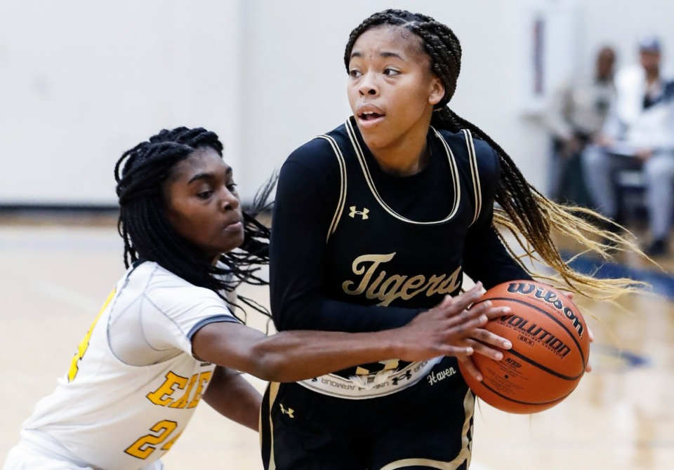 <strong>Whitehaven guard Se&rsquo;Quoia Allmond (right) drives the lane against Memphis Business Academy defender A&rsquo;nyah Rucker (left) during action Thursday, Jan. 2 2020 at Arlington High School.</strong> (Mark Weber/Daily Memphian)