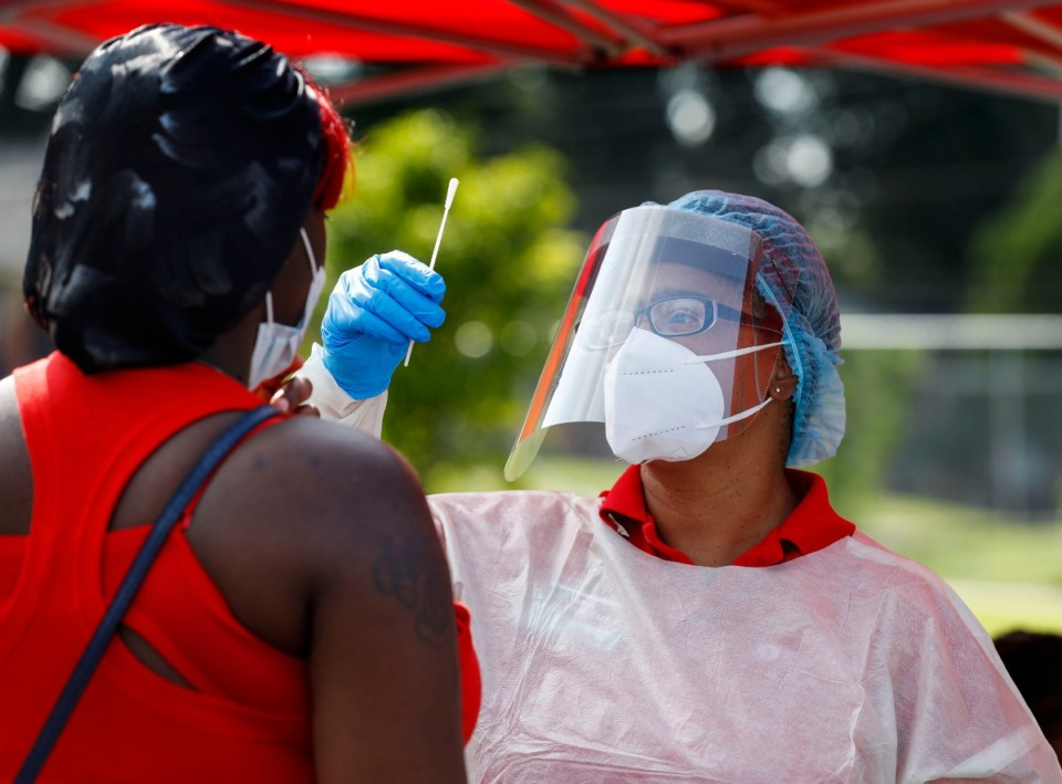 <strong>Christ Community Health Services staff members collect nasal swabs during a walk-up coronavirus testing in September at Orange Mound Health Center.</strong> (Mark Weber/Daily Memphian file)