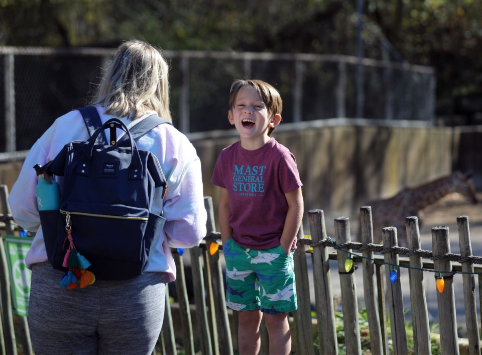 <strong>Five-year-old John Gilless laughs while getting his picture taken by Libby Sasse in front of Ja Raffe.</strong> (Patrick Lantrip/Daily Memphian)