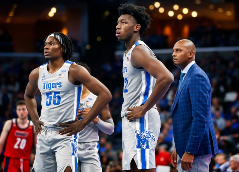 <strong>Precious Achiuwa (left), James Wiseman and Coach Penny Hardaway looked on during a break in action against UIC Friday, Nov. 8, 2019 at FedExForum.</strong> (Mark Weber/Daily Memphian file)