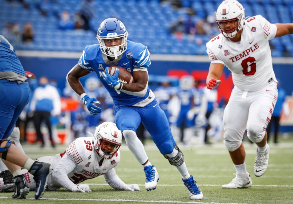 <strong>Memphis running back Rodrigues Clark (left) runs past the Temple defense for a touchdown during action on Saturday, Oct. 24, 2020 at Liberty Bowl Memorial Stadium</strong>. (Mark Weber/Daily Memphian file)