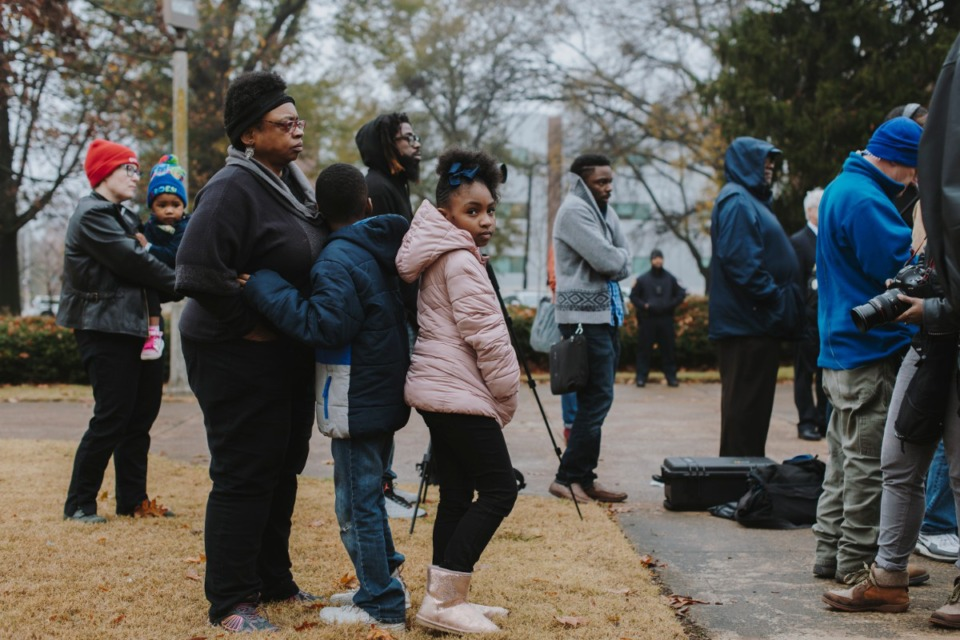 <strong>Emorie London (right) stands with Benjamin Hampton (center) and Carla Lock (left) at the press conference the morning after the Nathan Bedford Forrest statue was removed from Health Sciences Park. </strong>(Houston Cofield/Daily Memphian file)