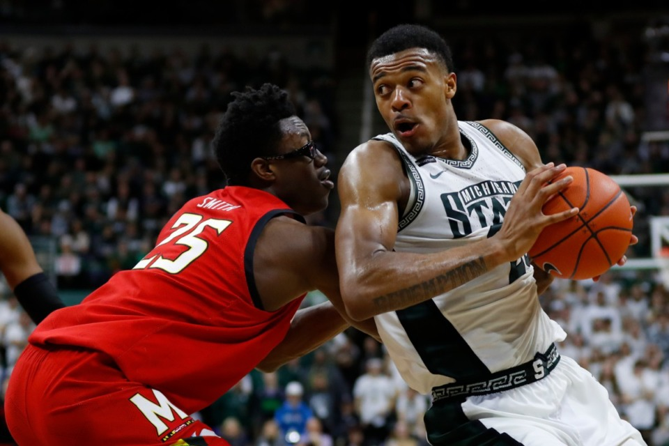 <strong>&ldquo;(Defense) is kind of like my bread and butter,&rdquo; said Xavier Tillman Sr., seen here in February(with ball). &ldquo;Also,&nbsp; rebounding is another key point I can bring in, as well as being that defensive anchor and prides himself on defense.&rdquo;</strong> (Paul Sancya/AP file)