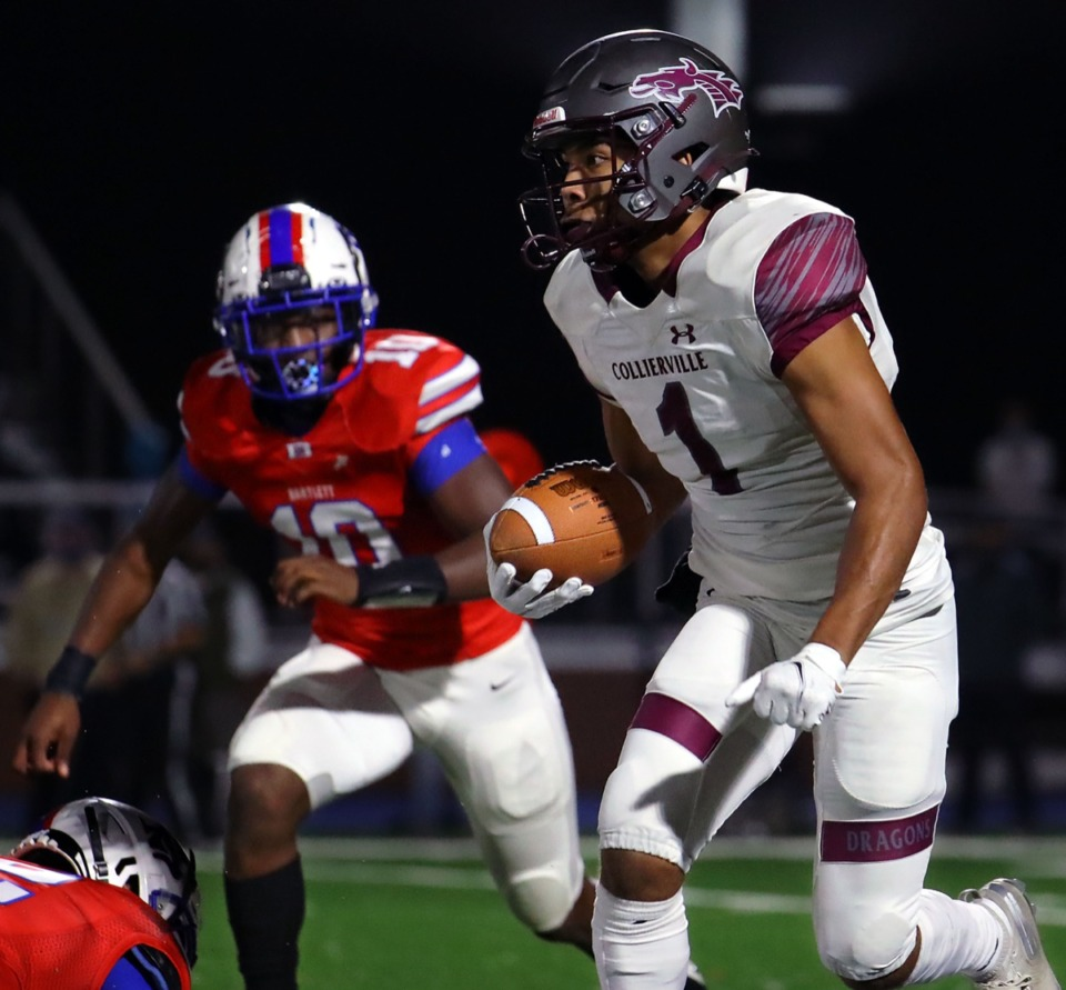 <strong>Collierville receiver Duple Travillion (1) dodges a Collierville player Friday night.</strong> (Patrick Lantrip/Daily Memphian)
