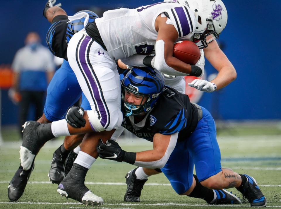 <strong>Memphis defender Cole Mashburn (right) brings down Stephen F. Austin running back Josh McGowen during action on Saturday, Nov. 21, 2020.</strong> (Mark Weber/The Daily Memphian)