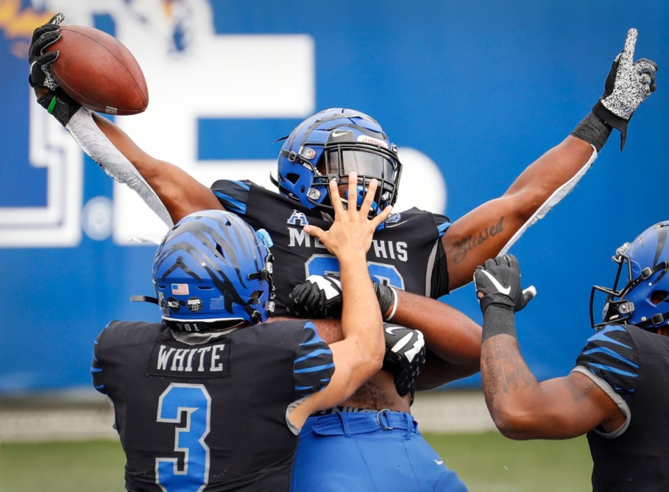 <strong>Memphis running back Marquavius Weaver (middle) celebrates a rushing touchdown during action against Stephen F. Austin on Saturday, Nov. 21, 2020.</strong> (Mark Weber/The Daily Memphian)