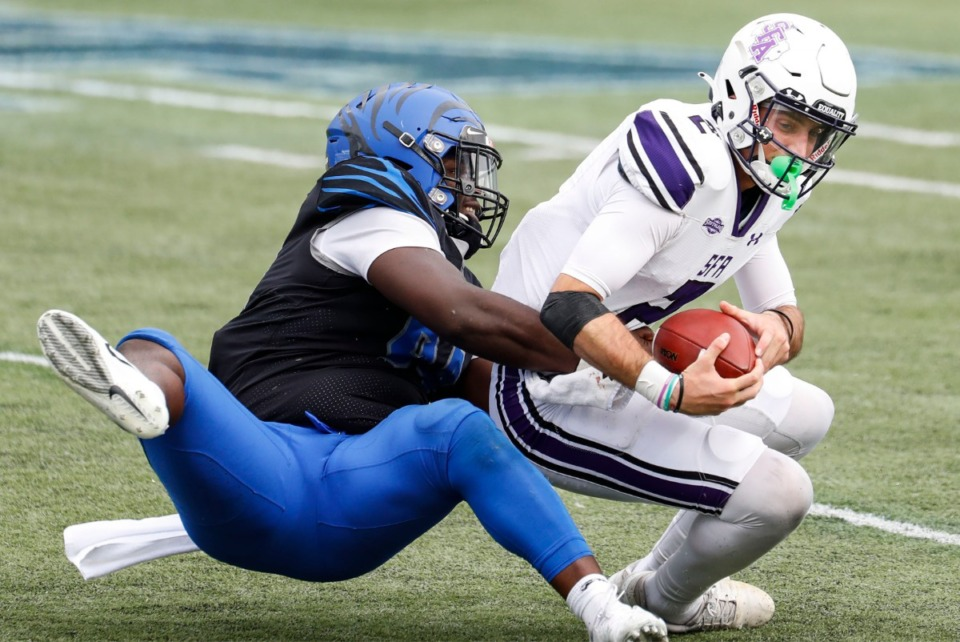 <strong>Memphis defender O'Bryan Goodson (left) sacks Stephen F. Austin quarterback Trae Self (right) during action on Saturday, Nov. 21, 2020.</strong> (Mark Weber/The Daily Memphian)