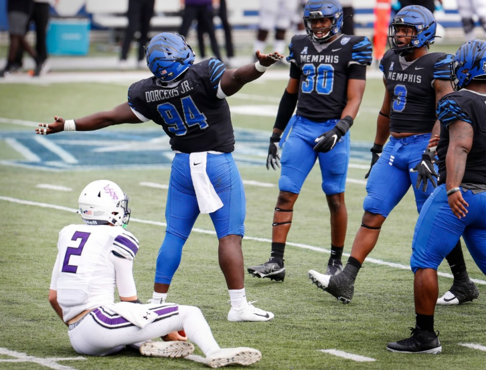 <strong>Memphis defender O'Bryan Goodson (middle) celebrates his sack against Stephen F. Austin during action on Saturday, Nov. 21, 2020.</strong> (Mark Weber/The Daily Memphian)