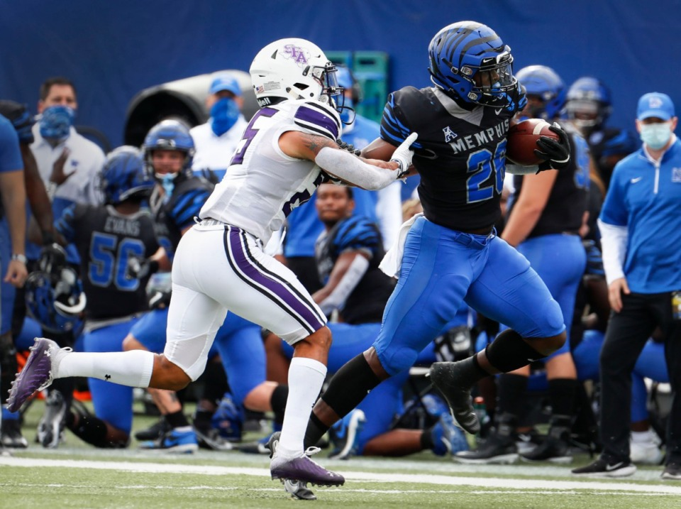 <strong>Memphis running back Marquavius Weaver (right) fights for a first down against Stephen F. Austin defender Tkai Lloyd (left) during action on Saturday, Nov. 21, 2020.</strong> (Mark Weber/The Daily Memphian)